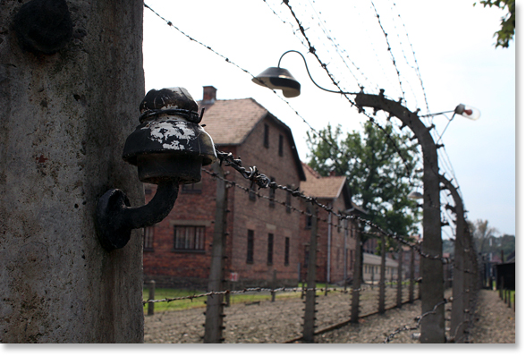 "Electrified fences at the Auschwitz concentration camp nearby to Birkenau. 1.3 million people were brought to Auschwitz, including ""1.1 million Jews, 140,000 Poles, 23,000 Roma, 15,000 Soviet prisoners of war, and 25,000 prisoners of other nationalities."" (The Auschwitz-Birkenau Memorial Guide Book) Photo by Nic Paget-Clarke."