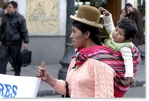 During a march/dancing through downtown La Paz, Bolivia, people from different communities support women's and children's rights to education, to read, to write, to overcome poverty.  Photo by Nic Paget-Clarke.