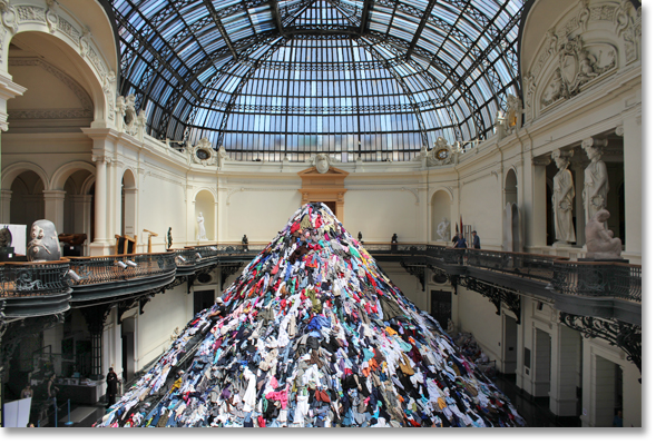 """Almas"" by French sculptor Christian Boltanski being constructed in the Museo de Bellas Artes in Santiago, Chile. The sculpture is composed of used clothes. Photo by Nic Paget-Clarke."