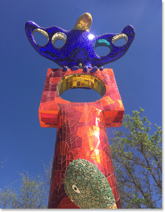 "Bird on a Square"" one of eight totem sculptures surrounding Queen Califia in Queen Califia's Magical Circle by internationally-acclaimed artist Niki de Saint Phalle. Kit Carson Park, Escondido, California. Photo by Nic Paget-Clarke."