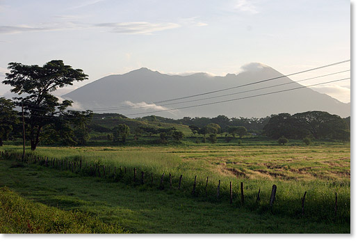 Fields and the Mombacho volcano in southwest Nicaragua. Photo by Nic Paget-Clarke.
