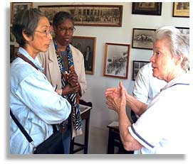 Nobuko Miyamoto and Robbie McCauley (center) and Sister Mary Beth, at the African American Historical Culture Center in Pennington Gap, Virginia. Photo by Nic Paget-Clarke.